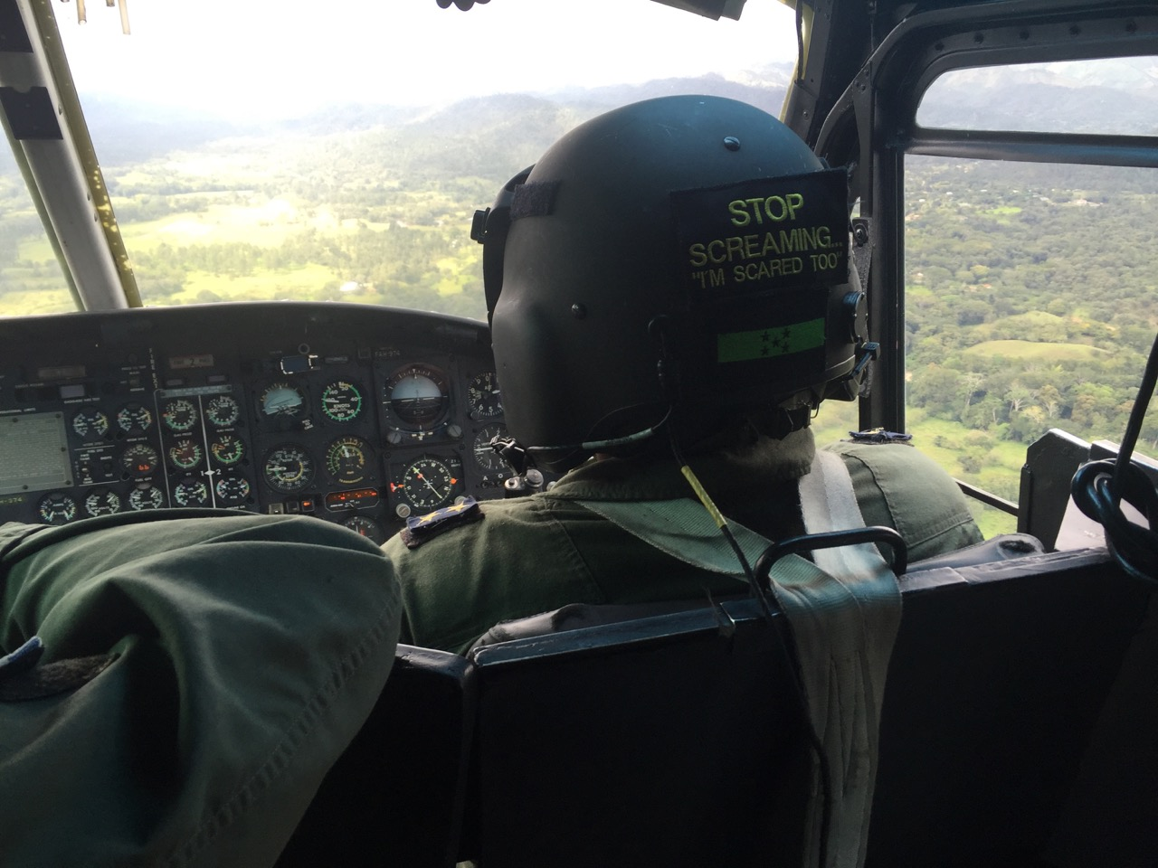 looking out over helicopter pilot flying over Honduras