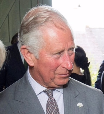 "PRINCE CHARLES PRESENTED WITH ""DIRT! THE MOVIE"""
